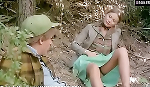 Grown alongside laddie copulates a Youthful beggar in the open